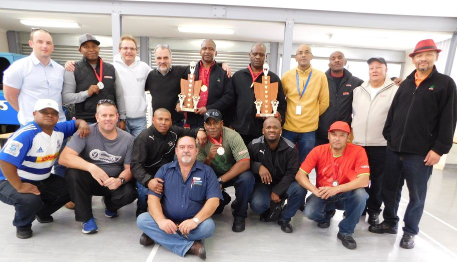 Back row, from left to right: Colm Kenny (Spar Ireland), Bulelani Raqowa (driver), Solly Engelbrecht (Spar Western Cape Distribution Director), Larry Vertue (Spar Transport Manager), Donovan Wilson (winner: Rigged Category), Headman Tukela (winner: Articulated Category), Anthony September (DTPW), Friedman Diyani (driver), Solly Patience (driver), and Willem Fryster (driver). Middle row: Ronald Brandt (DTPW), Wesley Falconer (Spar), Desmond Samuels (driver), Michale Ghigwedere (driver), Gerald May (driver), and Terence Kemp (driver). In front: Gerhard Kemp (driver trainer).