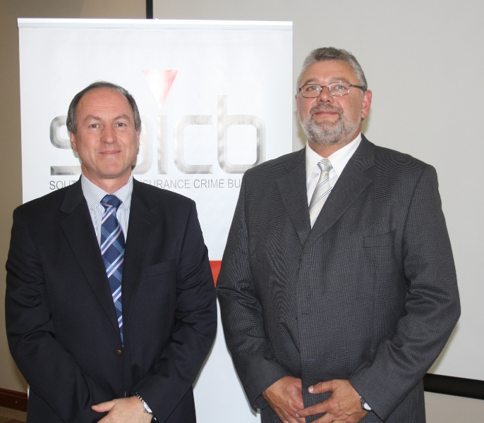 "From Left to Right: Dr Graham Wright (CEO of BACSA) and Hugo van Zyl, (COO of the SAICB) at the 3rd Annual ""Year In Review"" Breakfast of the South African Insurance Crime Bureau on 3 November 2010, JCC Woodmead."