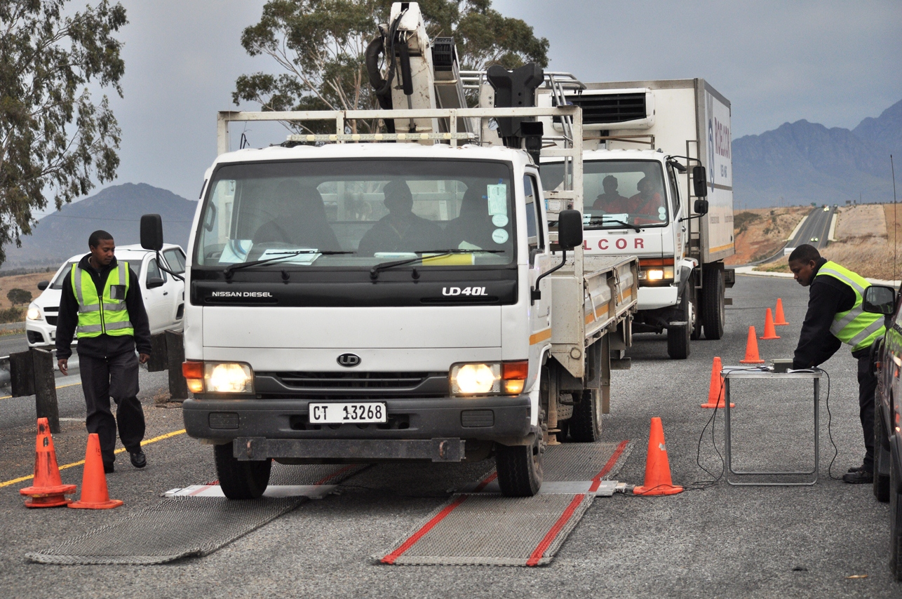 Weighbridge operators inspect a truck on the R46.