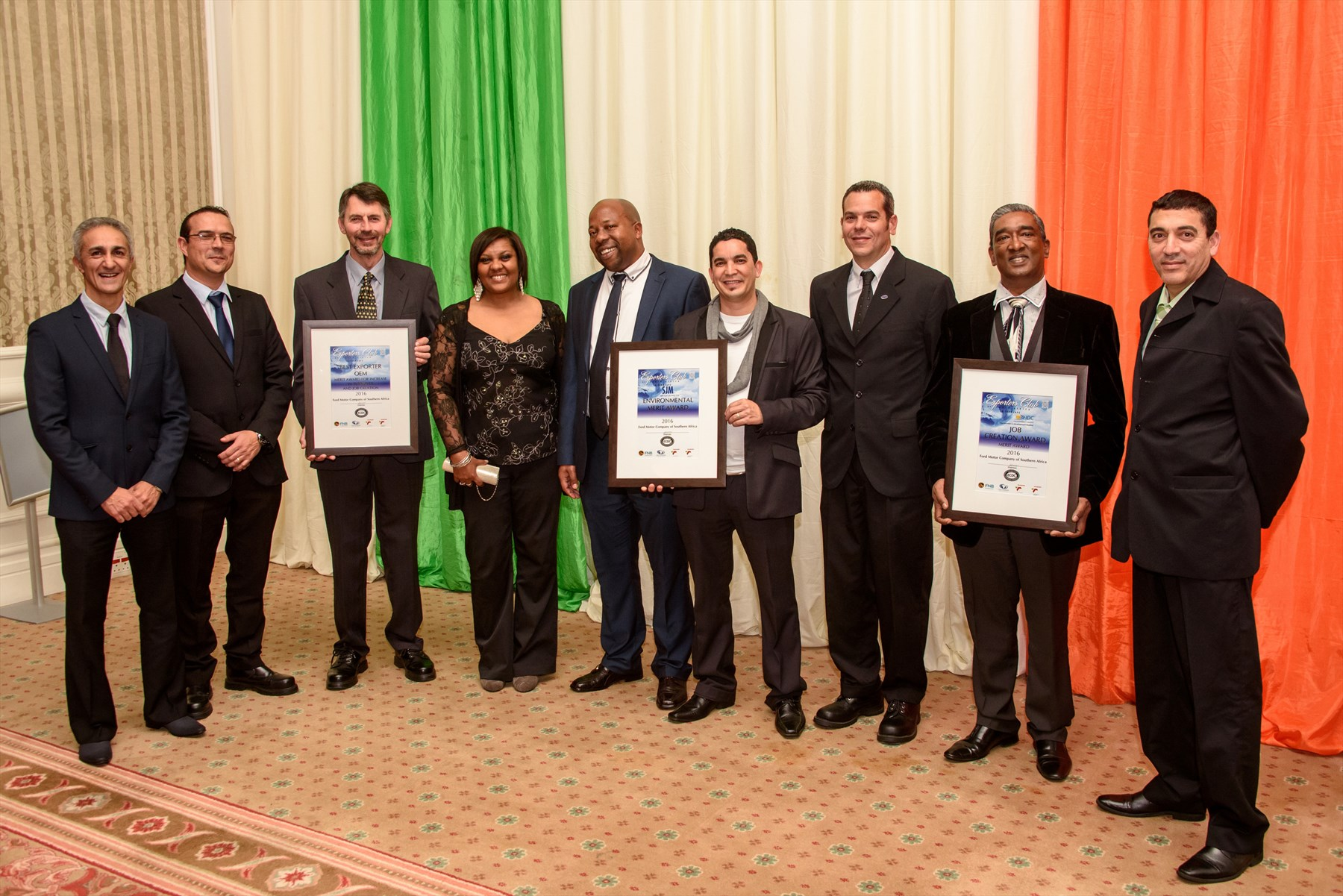 Members of the Ford Struandale Engine Plant team with the three Merit Awards received at the 2016 Exporter of the Year awards, held by the Exporters Club of South Africa – Eastern Cape. From left: Hyron Muniz (Production Manager), Shawn Sharp (Plant Engineering and Maintenance Manager), Julien Verstraeten (Resident Engineer), Fiona Kemp (Financial Analyst), Thabo Masete (HR Manager), Renaldo Meyers (Quality Manager), Neil Stander (Programs and Engineering Manager), Basil Raman (Operations Manager), Paul Brooks (Powertrain Operations Controller)