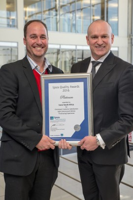 patrick-busschau-business-unit-director-of-ipsos-hands-over-the-platinum-award-to-brian-olson-gm-sub-saharan-sa-vice-president-of-sales-service-and-marketing_1800x1800